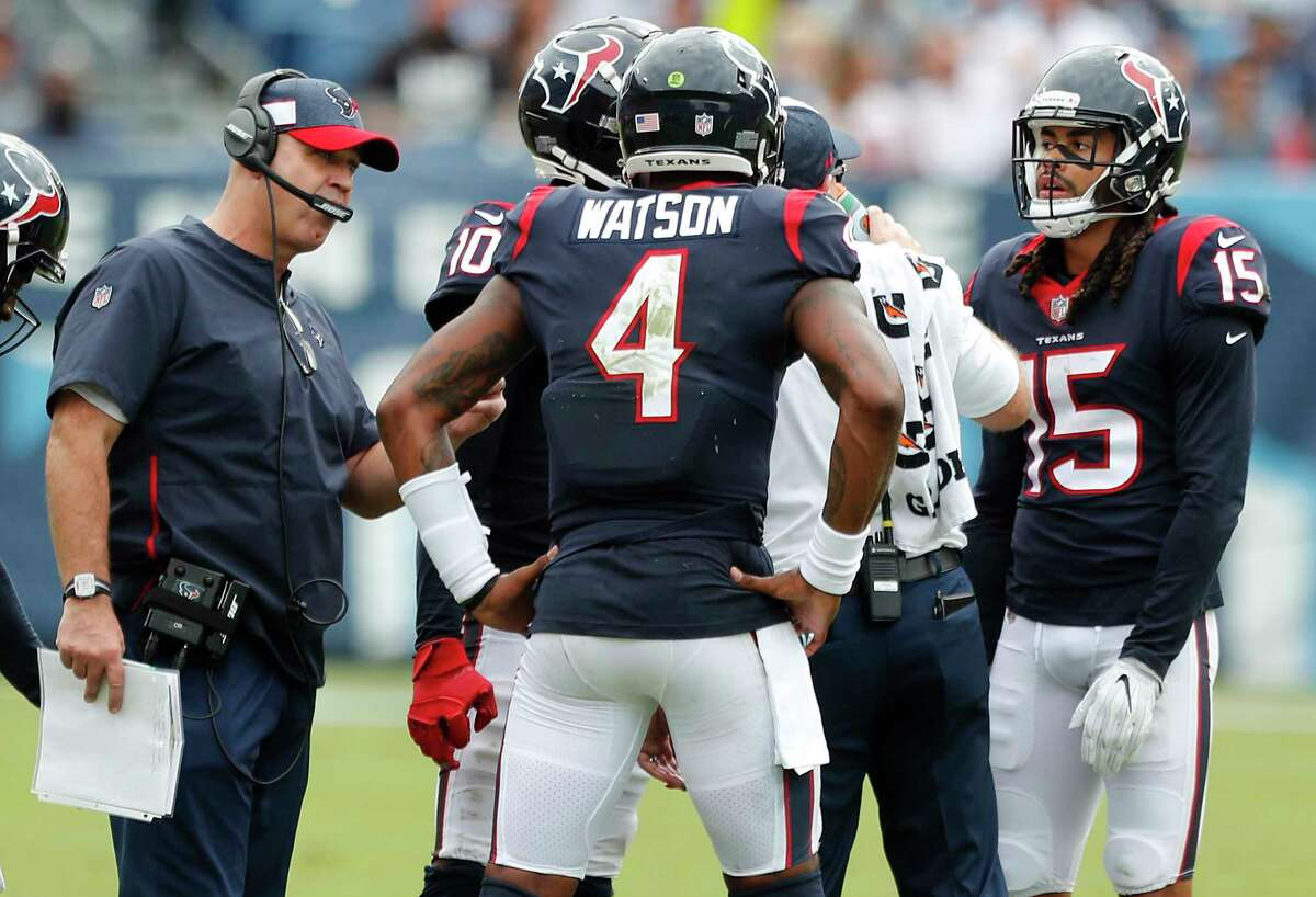 Houston Texans head coach Bill O'Brien works with quarterback Deshaun Watson (4) during a time out during the third quarter of an NFL football game against the Tennessee Titans at Nissan Stadium on Sunday, Sept. 16, 2018, in Nashville.
