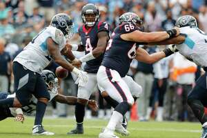 Houston Texans quarterback Deshaun Watson (4) loses the football as he is sacked by Tennessee Titans defensive tackle Jurrell Casey (99) and linebacker Harold Landry (58) during the third quarter of an NFL football game at Nissan Stadium on Sunday, Sept. 16, 2018, in Nashville.