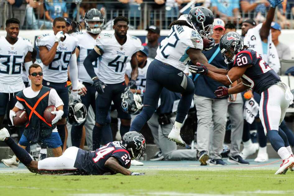 Tennessee Titans running back Derrick Henry (22) is run out of bounds by Houston Texans defensive backs Johnathan Joseph (24) and Justin Reid (20) during the fourth quarter of an NFL football game at Nissan Stadium on Sunday, Sept. 16, 2018, in Nashville.