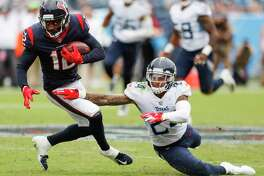 Houston Texans wide receiver Bruce Ellington (12) makes a first down catch against Tennessee Titans defensive back Kenny Vaccaro (24) during the fourth quarter of an NFL football game at Nissan Stadium on Sunday, Sept. 16, 2018, in Nashville.