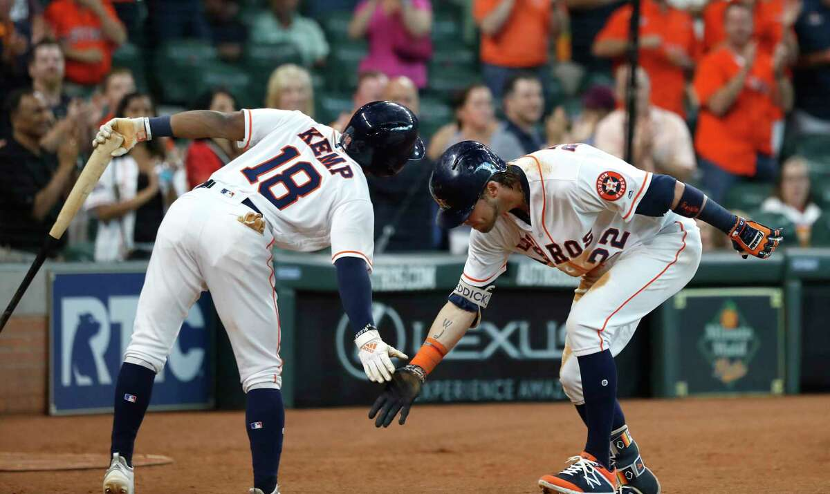 Houston Astros Josh Reddick celebrates his home run with Tony Kemp (18) during the seventh inning of an MLB game at Minute Maid Park, Sunday, September 16, 2018, in Houston.