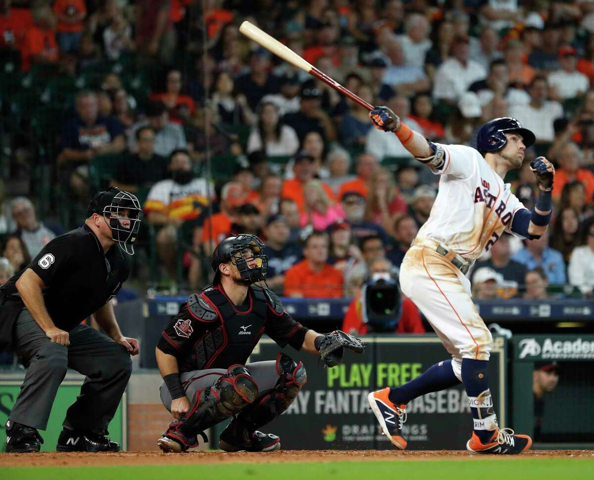 Houston Astros Josh Reddick (22) hits a home run during the seventh inning of an MLB game at Minute Maid Park, Sunday, September 16, 2018, in Houston.