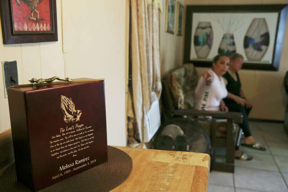 Melissa Ramirez' ashes sit on an altar at the home where she grew up in Rio Bravo, Texas, Sunday, Sept. 16, 2018. In back is her mother, Maria Cristina Benavides, 51, right, with her cousin, Leticia Montalvo, 50. Ramirez was found dead in an area off U.S. 83 in northwest Webb County on September 4th. She was one of four victims that according to reports, U.S. Border Patrol agent Juan David Ortiz, 35, confessed to killing within a two-week period. Photo: JERRY LARA, San Antonio Express-News / © 2018 San Antonio Express-News