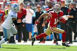 San Francisco 49ers' Dante Pettis runs after a catch in 1st quarter against Detroit Lions' Glover Quin during NFL game at Levi's Stadium in Santa Clara, Calif. on Sunday, September 16, 2018.