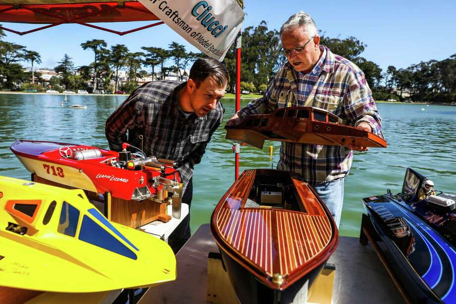 Matthew Ciucci chats with artisan Jim Renfrew (right) as they discuss the boats he made at Spreckels Lake. Photo: Gabrielle Lurie / The Chronicle / ONLINE_YES