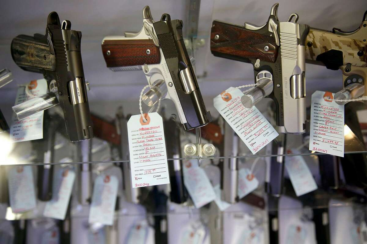 FILE - This Nov. 15, 2014 file photo, shows handguns in a display case at Metro Shooting Supplies, in Bridgeton, Mo. Gun sales have spiked in the region in the past year, and so have applications for concealed-carry permits. Policing experts say that with more guns come more gun thefts. (AP Photo/Jeff Roberson, File)