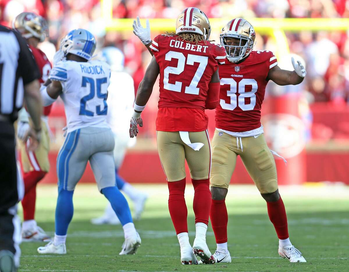 San Francisco 49ers' Antone Exum, Jr. (38) and Adrian Colbert (27) celebrate failed 4th down pass by Detroit Lions in final seconds of during Niners' 30-27 win in NFL game at Levi's Stadium in Santa Clara, Calif. on Sunday, September 16, 2018.
