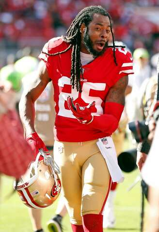 1464e5858 San Francisco 49ers  Richard Sherman is animated as he leaves the field  after Niners