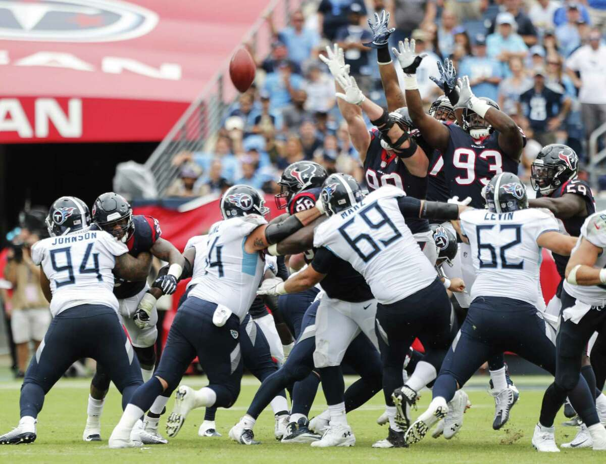 Houston Texans defenders leap in vain for Tennessee Titans kicker Ryan Succop's 42-yard field goal during the fourth quarter of an NFL football game at Nissan Stadium on Sunday, Sept. 16, 2018, in Nashville.