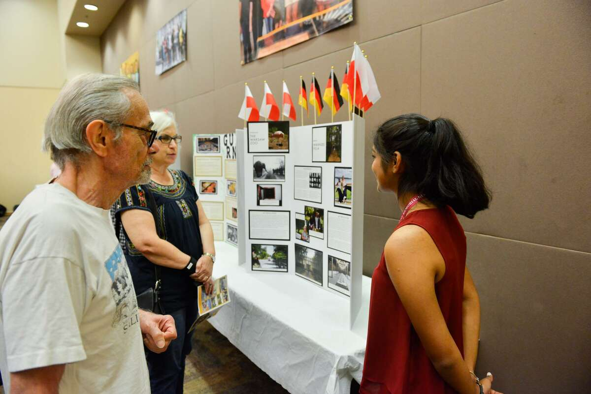 L.B. Feiner and Susan Albert talk with Health Careers High School Junior Esha Reddy about her exhibity during the Holocaust Study Seminar OPpen House and Reception Sunay on the Campus of the San Antonio Jewish Community.