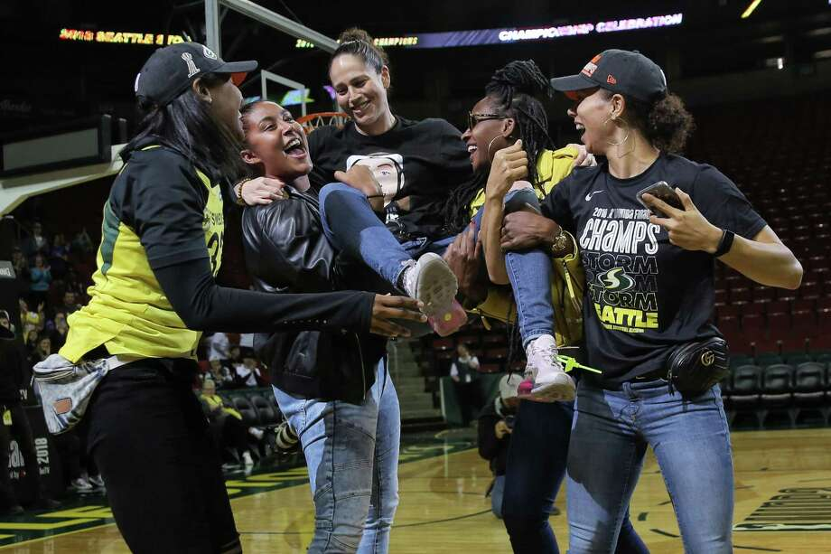Teammates lift up Seattle Storm guard Sue Bird, center, during a rally at KeyArena to celebrate the Storm winning the 2018 WNBA basketball championship, Sunday, Sept. 16, 2018, in Seattle. Photo: GENNA MARTIN, SEATTLEPI.COM / SEATTLEPI.COM