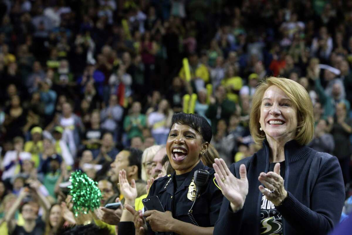 Seattle Mayor Jenny Durkan, right, and Police Chief Carmen Best cheer for the Seattle Storm during a rally at KeyArena to celebrate the Storm winning the 2018 WNBA basketball championship, Sunday, Sept. 16, 2018, in Seattle.