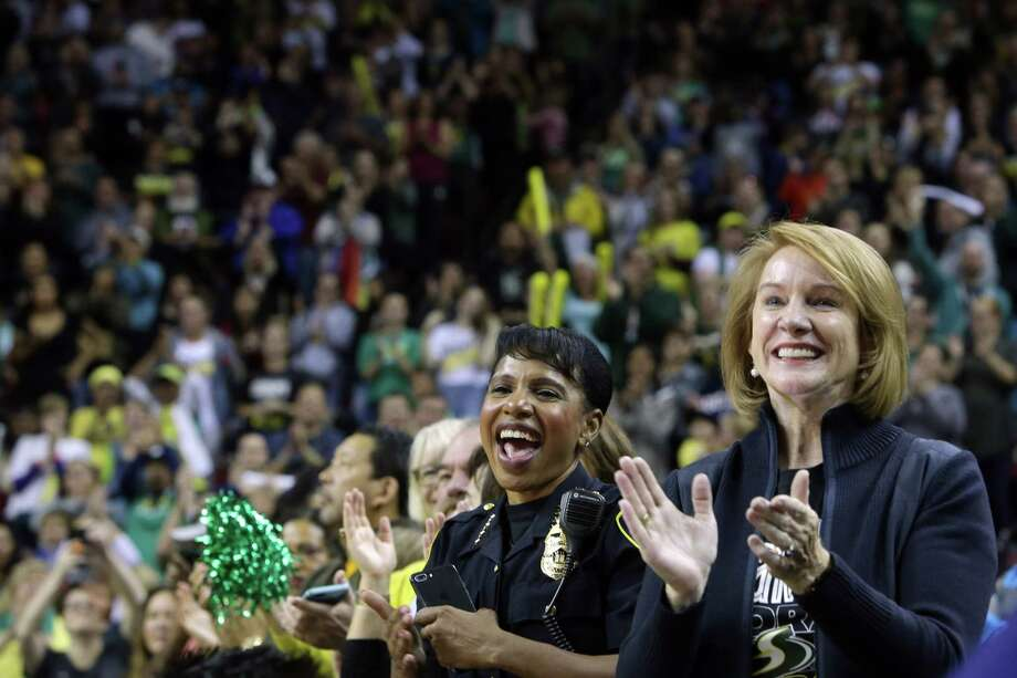 Seattle Mayor Jenny Durkan, right, and Police Chief Carmen Best cheer for the Seattle Storm during a rally at KeyArena to celebrate the Storm winning the 2018 WNBA basketball championship, Sunday, Sept. 16, 2018, in Seattle. Photo: GENNA MARTIN, SEATTLEPI.COM / SEATTLEPI.COM