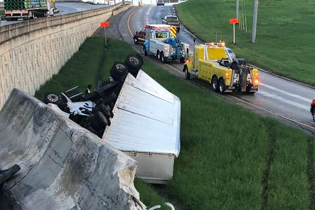 A barricade along the edge of the ramp was damaged at about 6 p.m. Sunday when a box truck smashed into it, and then apparently flipped over into the grassy median below.