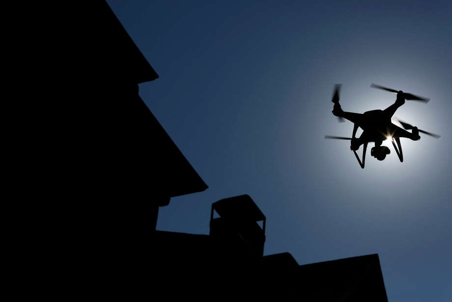 A Da-Jiang Innovations Science and Technology Co. (DJI) Phantom drone is flown during a property inspection following Hurricane Harvey in Houston, Texas. Photo: Bloomberg Photo By Luke Sharrett / © 2017 Bloomberg Finance LP