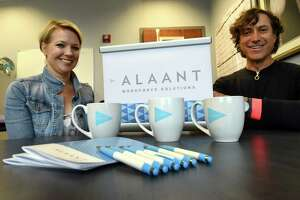 Miriam Dushane, managing director of Alaant Workforce Solutions, left, with Michael Fallone, Principal and Creative Director at id29, right, are pictured with the new branding for Linium Recruiting on Friday, Sept. 14, 2018, in Colonie, N.Y.  Fallone's Troy branding strategy firm came up with the new name and branding for the former Linium Recruiting, which is now Alaant Workforce Solutions, of Colonie. (Will Waldron/Times Union)