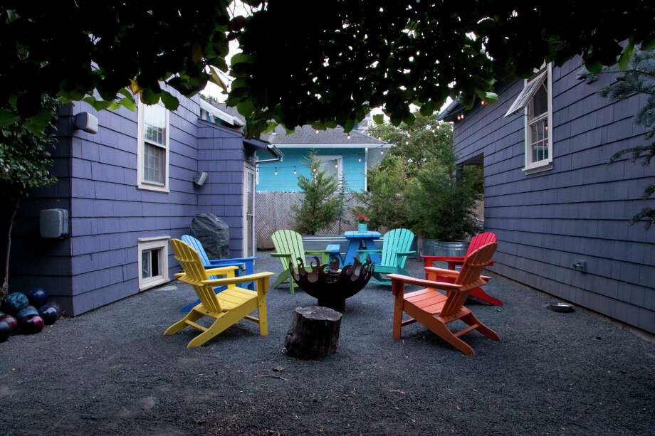 The space between the main house and the accessory dwelling unit features a fire pit and separate seating spaces. Photo: Photo For The Washington Post By Beth Nakamura / For The Washington Post