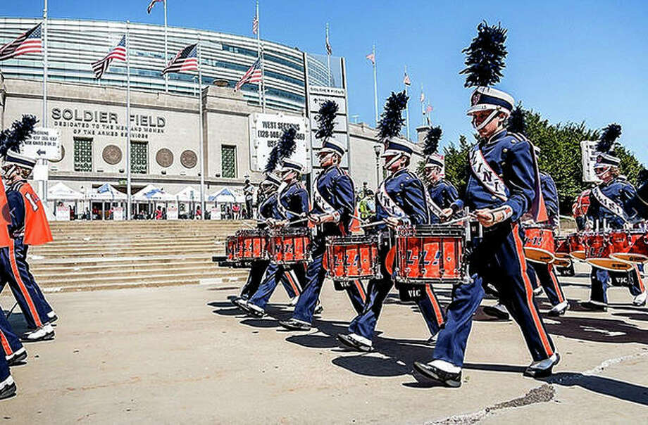 The Marching Illini performs in front of Soldier Field Saturday prior to the Illini's game there against South Florida. Illinois lost 25-19, its fourth straight loss at Soldier Field in front of an announced crowd of only 21,725.