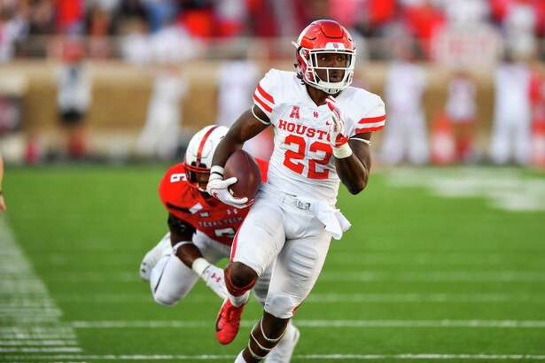 LUBBOCK, TX - SEPTEMBER 15: Terence Williams #22 of the Houston Cougars breaks the tackle of Riko Jeffers #6 of the Texas Tech Red Raiders during the game on September 15, 2018 at Jones AT&T Stadium in Lubbock, Texas. Texas Tech won the game 63-49.