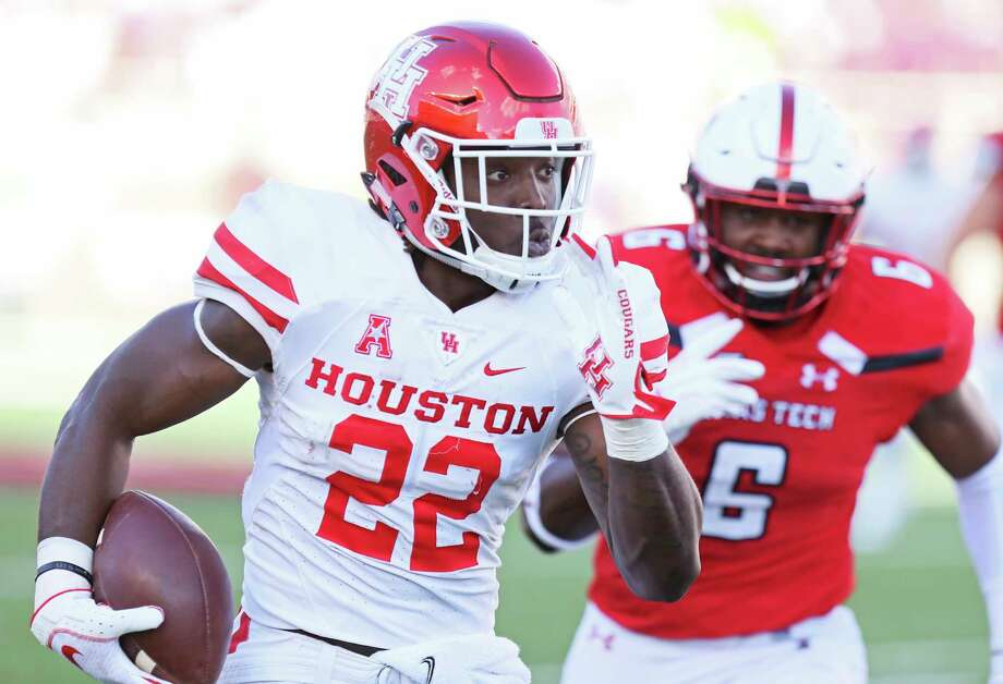PHOTOS: UH vs. TSU Houston's Terence Williams (22) carries the ball during an NCAA college football game against Texas Tech, Saturday, Sept. 15, 2018, in Lubbock, Texas. (Sam Grenadier/Lubbock Avalanche-Journal via AP) >>>See photos from UH's game against Texas Southern on Saturday, Sept. 22, 2018 ... Photo: Sam Grenadier, Associated Press / Lubbock Avalanche-Journal
