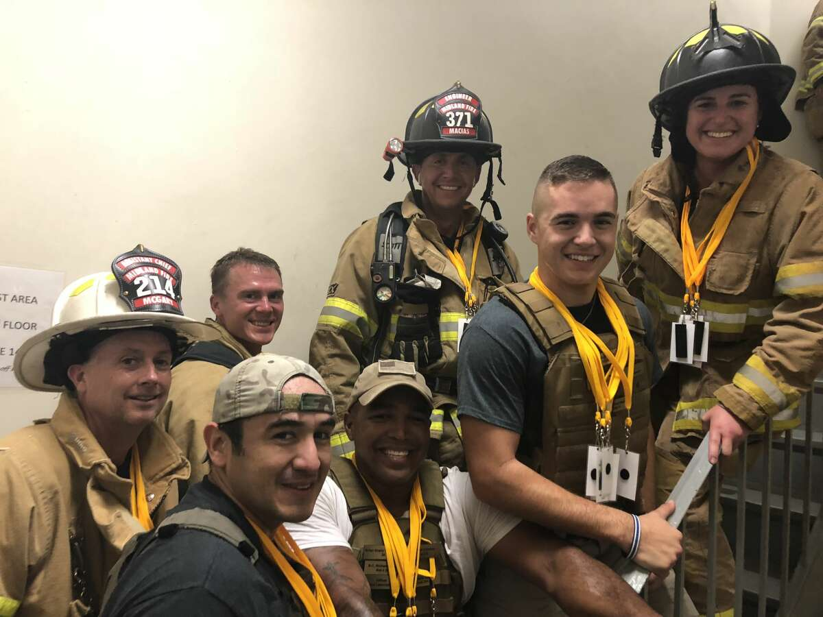 Chief Brian McGary, back row from left, Landry Adkins, Victor Macias and Samantha Medley; and Elijah Quesada, front row from left, Gabriel Dominguez and Cameron Tarango during a stair climb when it was held downtown
