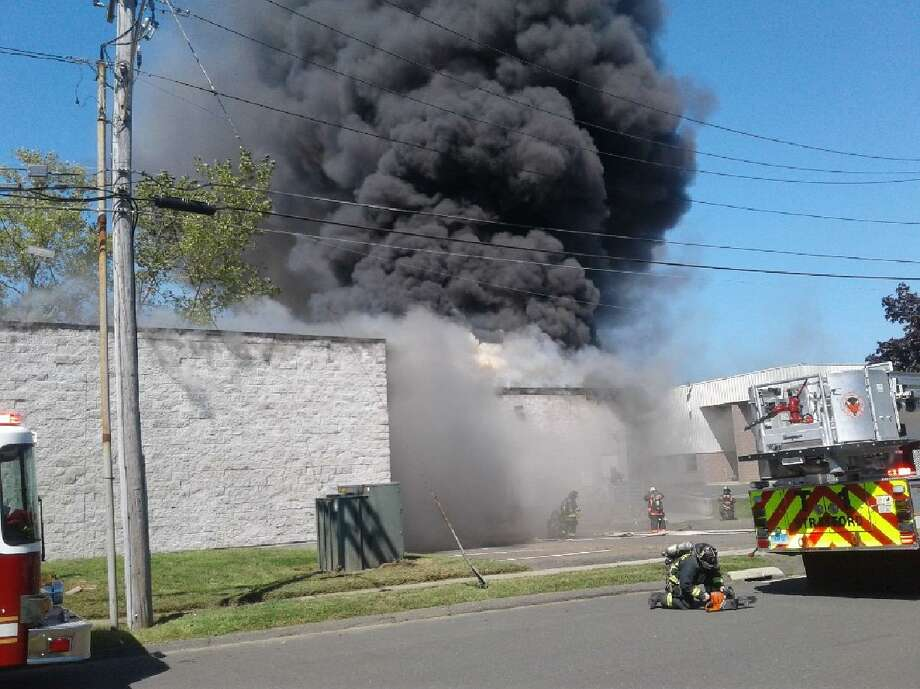 Firefighters battled a blaze at the Kubtec Medical Imaging building on Research Drive in Stratford, Conn. Sunday, September 16, 2018. It was reported that nobody was in the building and no one was hospitalized for any injuries stemming from the fire. Photo: Contributed Photo / Contributed Photo / Connecticut Post Contributed