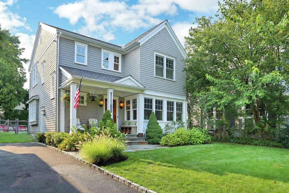 Newly listed by Real Living Real Estate, 3 Fairfield Ave. in Old Greenwich was built in 2012 and well maintained by its original owners since. The three-bedroom Nantucket colonial is within walking distance to the train station, Old Greenwich Village, local parks and the beach. Photo: Real Living Real Estate / ONLINE_CHECK