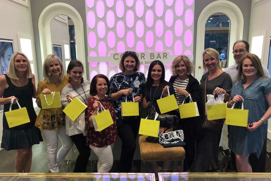 Katy ISD teachers and administrators show off their Kendra Scott purchases where the Katy ISD Education Foundation teamed up with the jewelry store to give back to the district. Photo: Katy ISD / Katy
