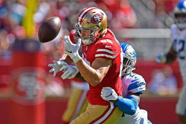 San Francisco 49ers' George Kittle (85) drops a pass while being tackled by Detroit Lions' Quandre Diggs (28) in the third quarter on Sunday, Sept. 16, 2018 at Levi's Stadium in Santa Clara, Calif. The San Francisco 49ers defeated the Detroit Lions 30-27. (Jose Carlos Fajardo/Bay Area News Group/TNS)