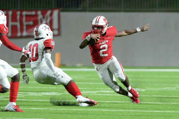Deondrick Glass (2) of Katy carries the ball around Taylen Blaylock (10) of Atascocita during the fourth quarter of a high school football game between the Katy Tigers and the Atascocita Eagles on Saturday, September 8, 2018 at Legacy Stadium, Katy, TX.