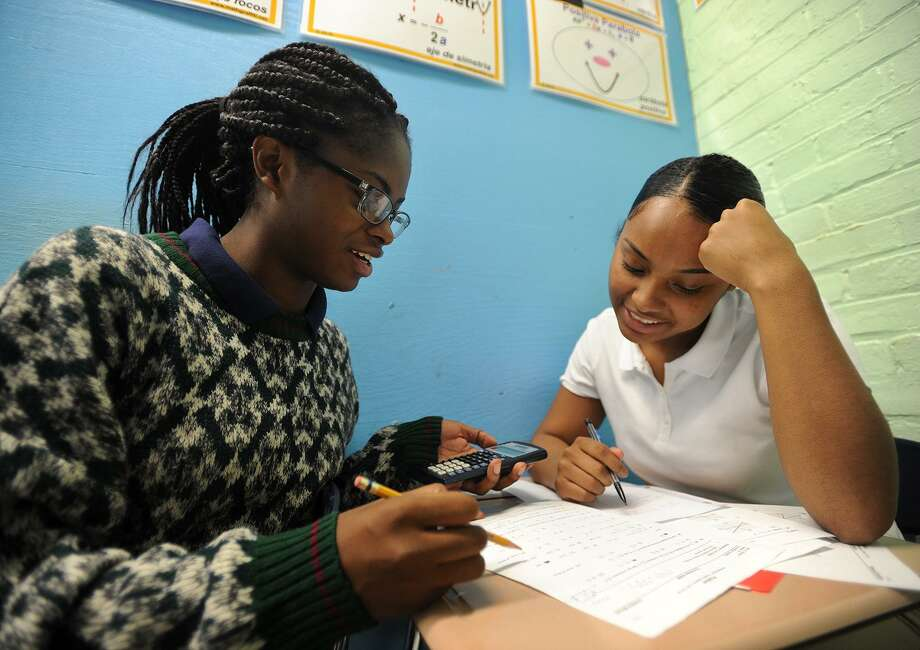 Seniors Christine Menard, left, and Deborah Davidson, both 17 of Bridgeport, work together during pre-calculus class at The Bridge Academy charter school in Bridgeport, Conn. on Wednesday, September 12, 2018. The school has experienced a drop in enrollment which may be due to the opening of the new Harding High School this fall. Photo: Brian A. Pounds / Hearst Connecticut Media / Connecticut Post