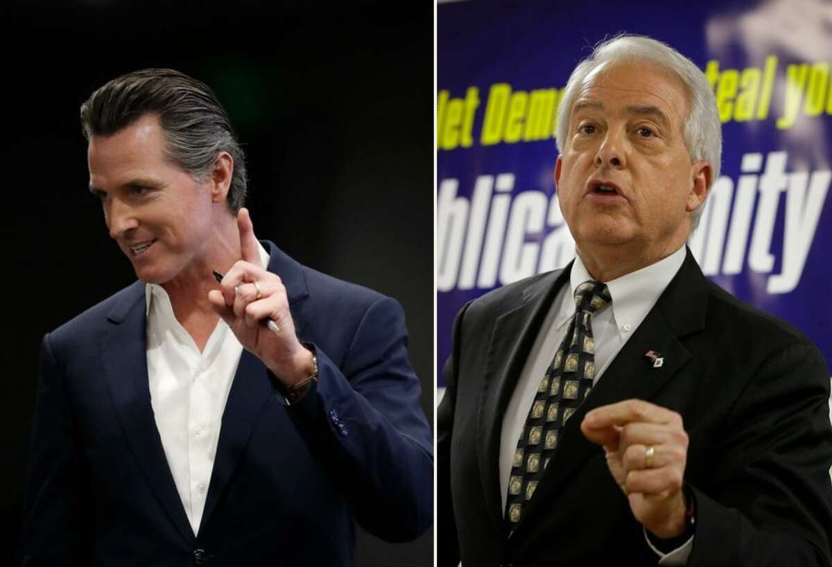 Gavin Newsom, left, the Democratic candidate for governor, and his Republican opponent, John Cox.