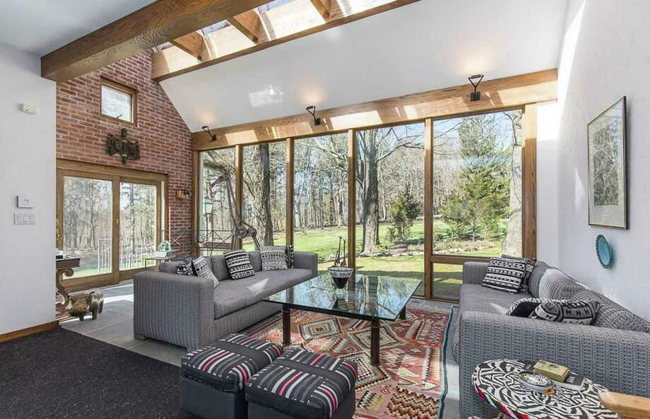 An architectural masterpiece, the sunroom at 26 Westward Road in Woodbridge overlooks the expansive yard with skylights and walls of windows that brings in the beauty of natural surroundings. Photo: Real Living Wareck D'Ostilio / ONLINE_CHECK