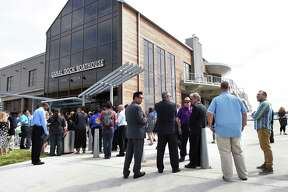 People mill about after the ribbon cutting for the Canal Dock Boathouse in New Haven on September 17, 2018.