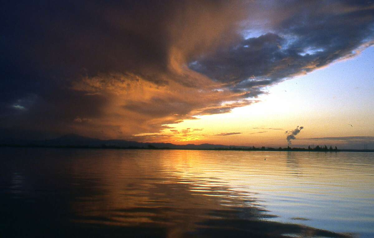 Clouds seem to swirl in refracted light during a September sunset on the San Joaquin Delta