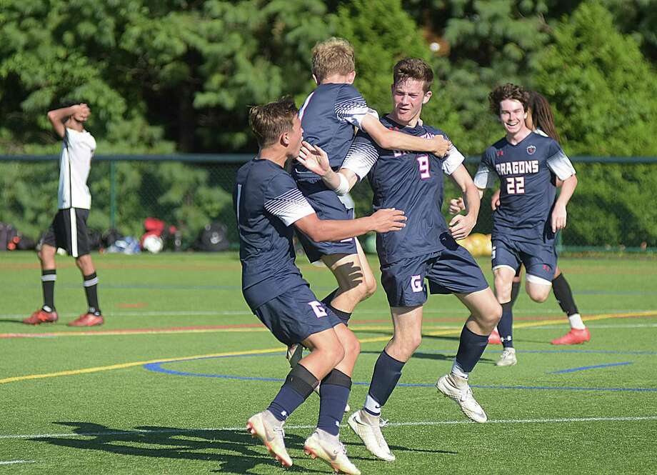 Kyle Merzon (9) is greeted by Greens Farms Academy teammates after scoring the game-tying goal in Saturday's 1-1 tie with New England regional power St. Andrew's of Rhode Island in Westport. Photo: Contributed Photo/Greens Farms Academy / GFA Athletic Communications