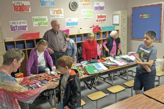 Residents from Colonial Oaks Assisted Living and Memory Care Center in Sugar Land recently delivered boxes of donated school supplies to the Williams Schools.