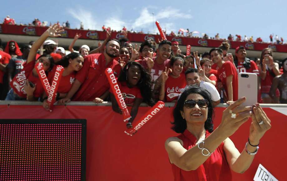 University of Houston president Renu Khator takes a selfie with fans during the second half of a college football game at TDECU Stadium, Sept. 8, 2018. Enrollment at UH has hit a new record, with a headcount of 46,355 students for fall 2018. Photo: Karen Warren, Houston Chronicle / Staff Photographer / © 2018 Houston Chronicle