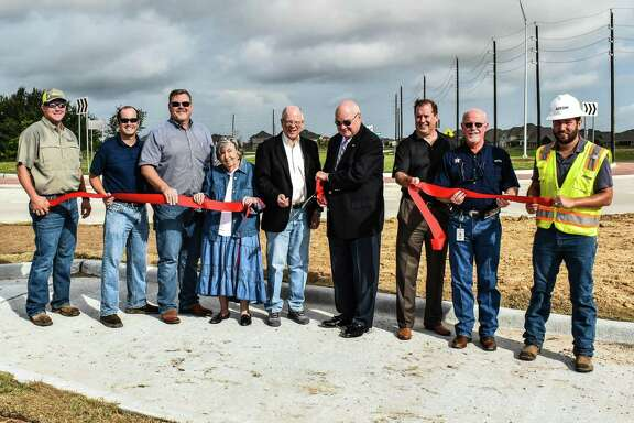 Fort Bend County officials turned out for the Sept. 7 ribbon cutting of theSpring Green Roundabout.Pictured from left are Michael Boenig, Allgood Construction; Chris Debaillon, Assistant County Engineer - Traffic; Stacy Slawinski, Assistant County Engineer - Projects; Lila Smith, Precinct 3 Project Manager; Precinct 3 Commissioner Andy Meyers; County Judge Bob Hebert; Matthew Brannen, BGE; Richard Stolleis, County Engineer; and Guillermo Gomez Salas, AECOM