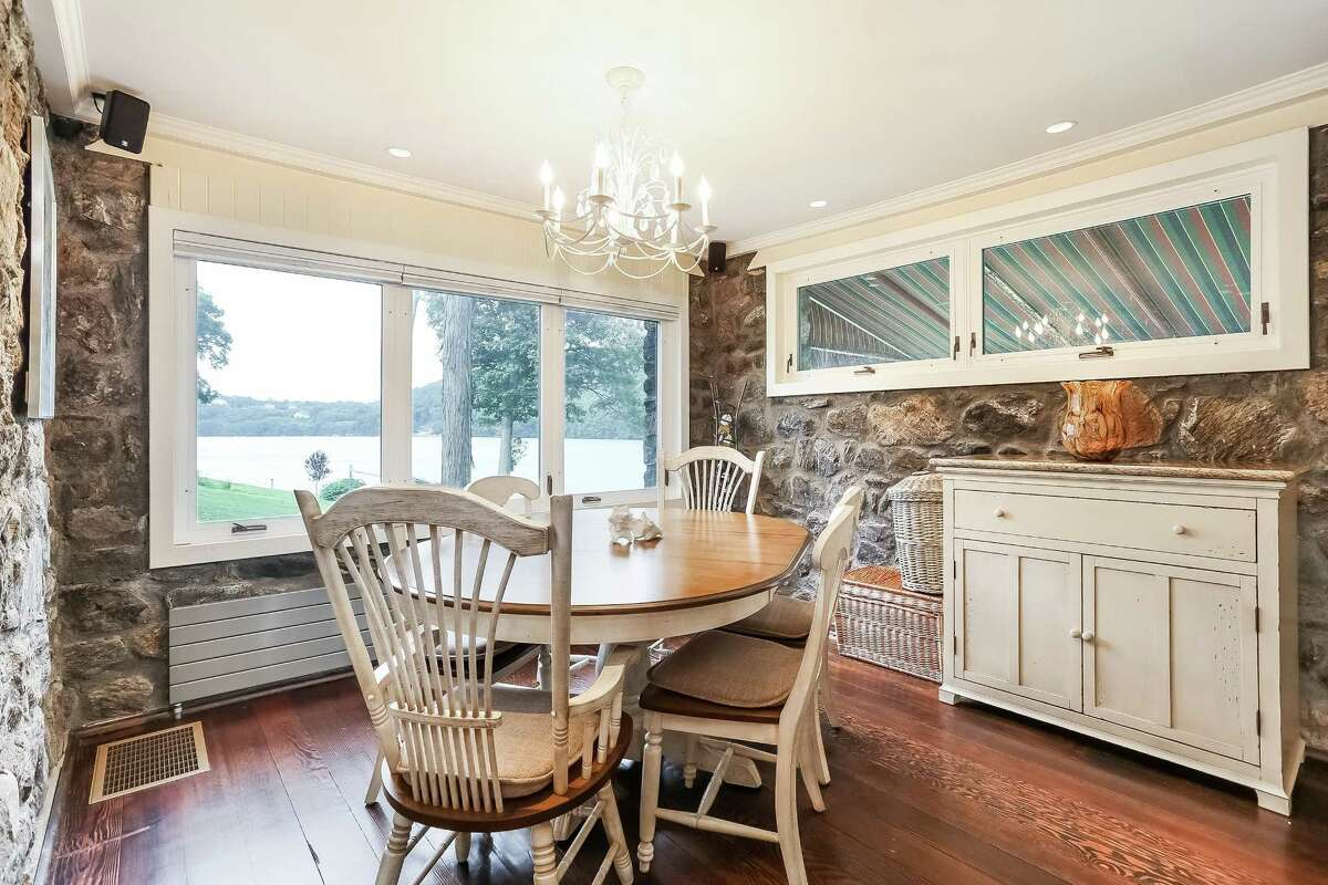 The country-style lakefront cottage at 73 Ta'agan Point in Danbury has nearly 50 feet of direct waterfront.