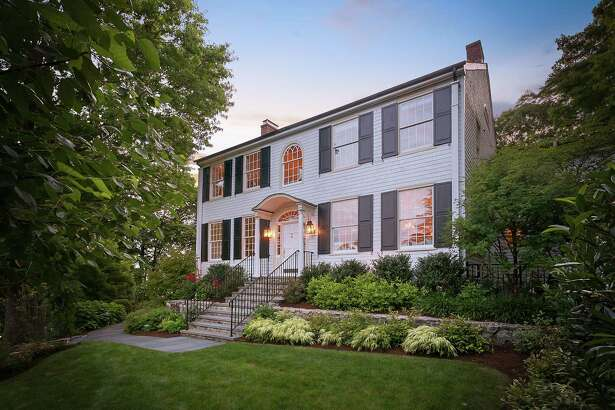 "The 16-room antique colonial at 33 Ferry Lane East is called ?'On the Rocks?"" and it sits on a hill along the Saugatuck River."