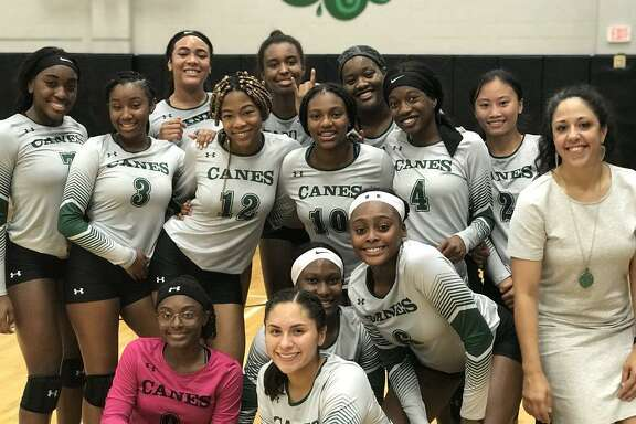 The Hightower volleyball team celebrates an Aug. 28 victory against Terry, part of a strong start to the District 24-5A season that included four wins in the Hurricanes' first five matches. One year after a winless district season, Hightower is on pace for its first playoff berth.
