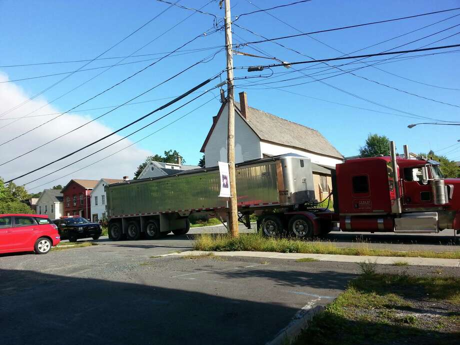 A tractor trailer is stopped and weighed by State Police on Partition Street last week on its way to the Dunn construction and demolition debris landfill in Rensselaer. Several trucks were ticketed for being heavier than allowed under state transportation law. Photo: Photo Provided