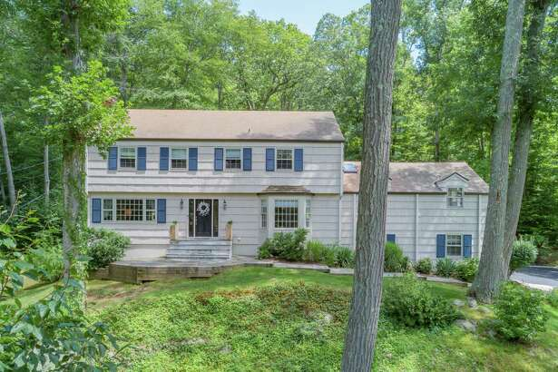 The Garrison colonial house at 111 Glen Drive sits on a 1.3-acre level and sloping property.