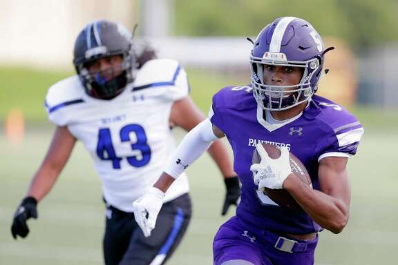 Ridge Point's Devin Gunter (5) outpaces Dekaney's Andrew Forbes (43) during the first half of their game at Kenneth Hall Stadium Saturday, Sep. 15, in Missouri City.