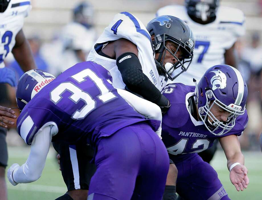 Dekaney's Carvarcean Moss (4) is sandwiched by Ridge Point's Preston Steszweski (37) and Josh Medina (42) during the first half of their game at Kenneth Hall Stadium Saturday, Sep. 15, 2018 in Missouri City, TX. Photo: Michael Wyke, Houston Chronicle / Contributor / © 2018 Houston Chronicle
