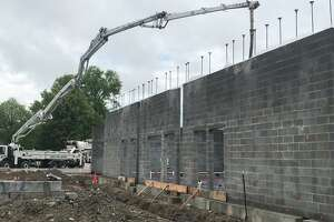 Walls going up at the Newtown Community Center construction site at the Fairfield Hills campus.