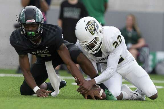 Conroe linebacker LaTravion Lewis (22) knocks the ball away from Mayde Creek quarterback Jacoby Wilson (8) during the first quarter of a non-district high school football game at Legacy Stadium on Saturday, Sept. 1, 2018, in Katy. Wilson had a much different performance against Nimitz, scoring five touchdowns to lead the Rams to victory.