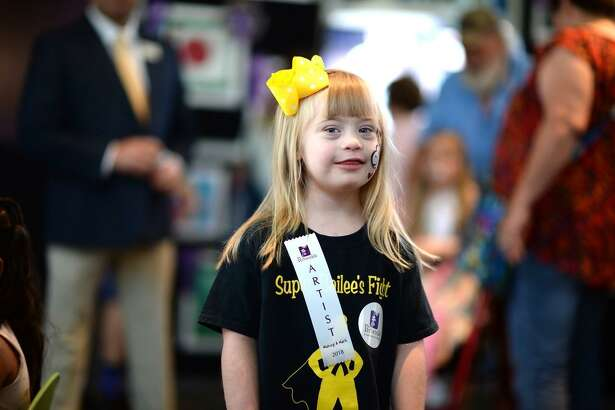 On Saturday, Sept. 8, the Periwinkle Foundation unveiled the 28th Making A Mark art exhibit consisting of art and creative writing by children touched by cancer and blood disorders at Texas Children?'s Cancer and Hematology Centers. Shown here is Bailee Malgren, 5.