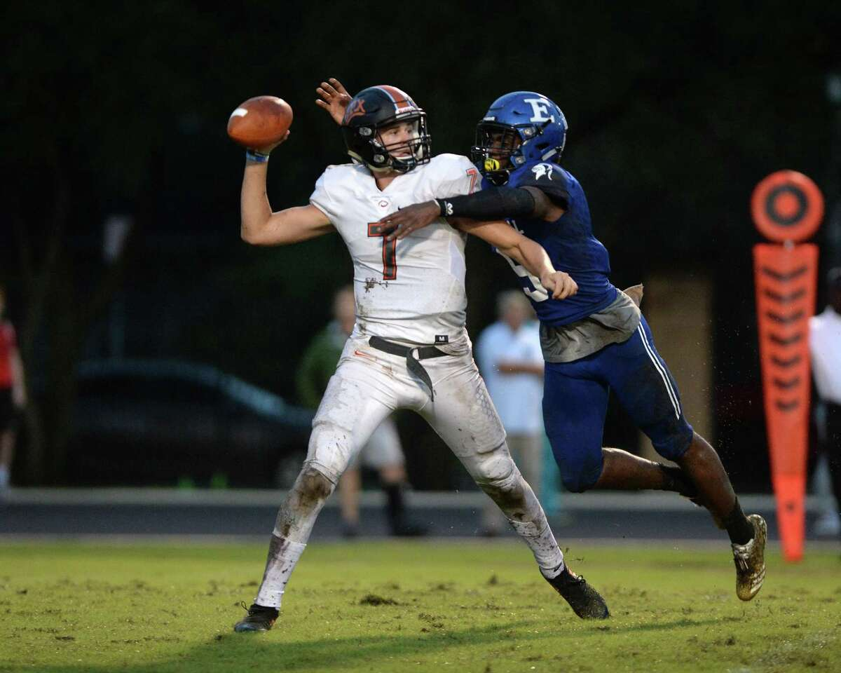 Quarterback Grant Gunnell (7) of St. Pius X is sacked by Jordan Wells (9) of Episcopal in the second quarter of a high school football game between the Episcopal Knights and the St. Pius X Panthers on Friday, Sept. 14, at Episcopal High School in Bellaire.